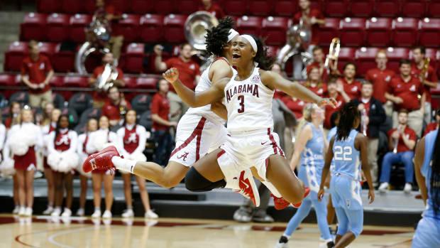Jordan Lewis and Alabama celebrates defeating North Carolina