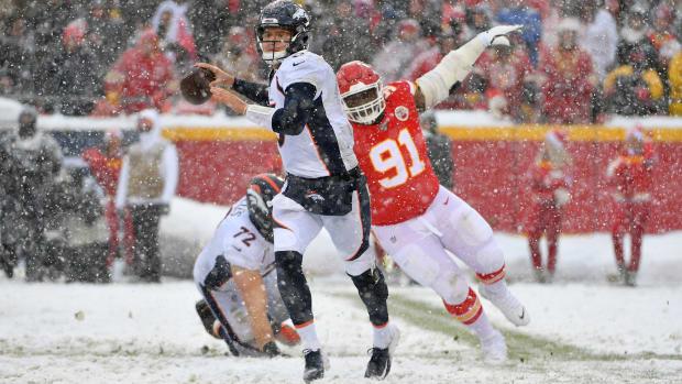 Denver Broncos quarterback Drew Lock (3) throws a pass as Kansas City Chiefs nose tackle Derrick Nnadi (91) attempts the sack during the second half at Arrowhead Stadium.