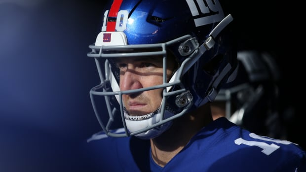 Dec 15, 2019; East Rutherford, NJ, USA; New York Giants quarterback Eli Manning (10) waits in the tunnel during player introductions before a game against the Miami Dolphins at MetLife Stadium.