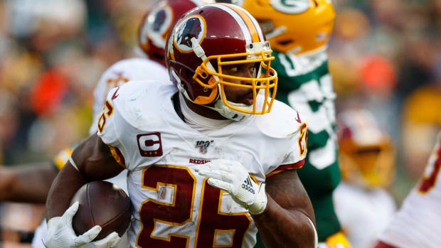 week 16 start em sit em adrian peterson redskins