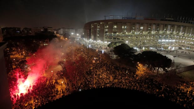 Protesters and police clash outside Barcelona's Camp Nou