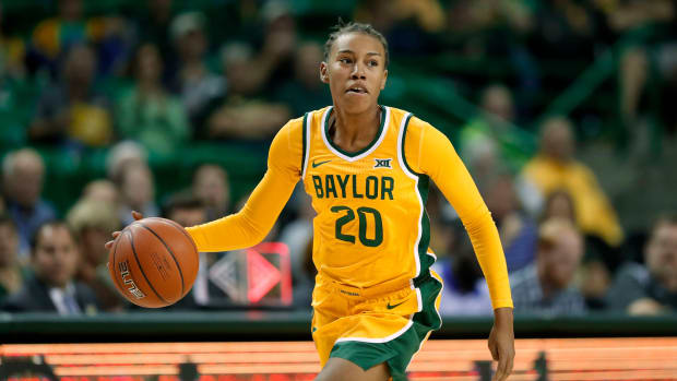 Baylor's Juicy Landrum broke the NCAA record for three-pointers made in a game with 14.