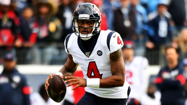 Dec 15, 2019; Nashville, TN, USA; Houston Texans quarterback Deshaun Watson (4) scrambles in the pocket during the first half against the Tennessee Titans at Nissan Stadium. Mandatory Credit: Christopher Hanewinckel-USA TODAY Sports