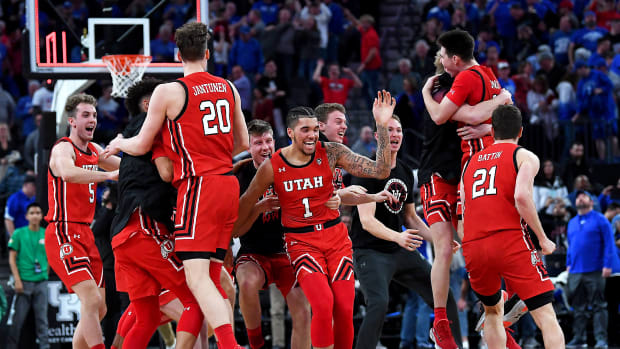 Dec 18, 2019; Las Vegas, NV, USA; Utah Utes players celebrate moments after defeating the Kentucky Wildcats 69-66 at T-Mobile Arena. Mandatory Credit: Stephen R. Sylvanie-USA TODAY Sports