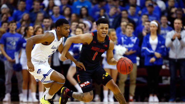 Maryland Terrapins guard Anthony Cowan Jr. (1) dribbles the ball against Seton Hall Pirates guard Anthony Nelson (2) during the first half at Prudential Center.