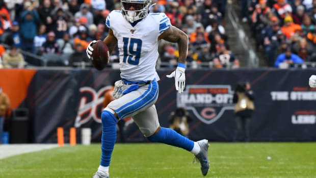 Detroit Lions wide receiver Kenny Golladay (19) runs with the Baltimore after a catch against the Chicago Bears during the first quarter at Soldier Field.