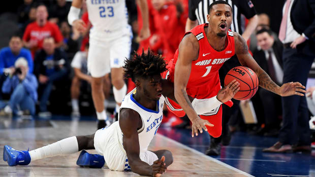 Dec 21, 2019; Las Vegas, Nevada, USA; Kentucky Wildcats forward Kahlil Whitney (2) and Ohio State Buckeyes guard Luther Muhammad (1) chase the ball out of bounds during the first half at T-Mobile Arena. Mandatory Credit: Stephen R. Sylvanie-USA TODAY Sports