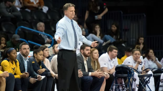 West Virginia Mountaineers head coach Mike Carey reacts during the game against the Texas Longhorns during the women's Big 12 Conference Tournament at Chesapeake Energy Arena