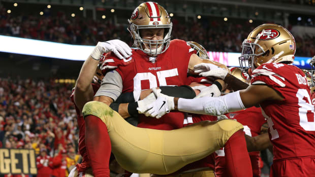 Members of the San Francisco 49ers celebrate a touchdown.