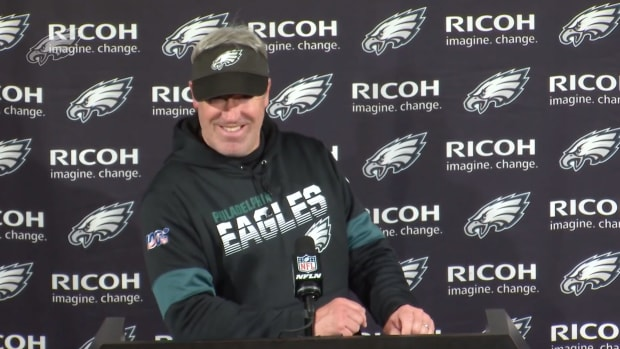Eagles coach Doug Pederson reacts after a fan crashes his press conference