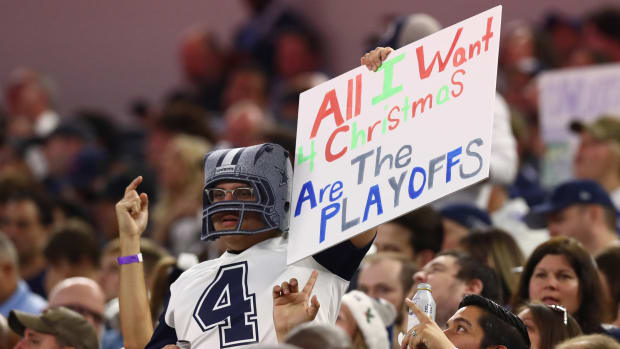 A Dallas Cowboys fan holds a sign at Rams game