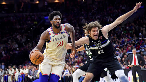 Dec 25, 2019; Philadelphia, Pennsylvania, USA; Philadelphia 76ers center Joel Embiid (21) drives to the basket against Milwaukee Bucks center Robin Lopez (42) during the second quarter at Wells Fargo Center. Mandatory Credit: Eric Hartline-USA TODAY Sports