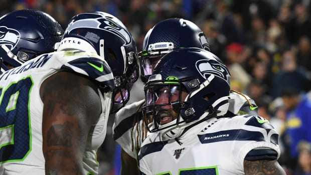 Seattle Seahawks defensive back Quandre Diggs (37) celebrates returning an interception for a touchdown against the Los Angeles Rams in the second half of a NFL game at Los Angeles Memorial Coliseum.
