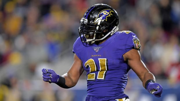 Baltimore Ravens running back Mark Ingram reacts against the Los Angeles Rams during the first half at Los Angeles Memorial Coliseum.