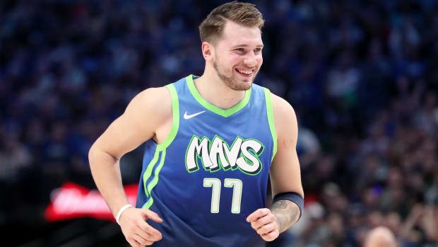 Dec 26, 2019; Dallas, Texas, USA;  Dallas Mavericks forward Luka Doncic (77) reacts during the second quarter against the San Antonio Spurs  at American Airlines Center. Mandatory Credit: Kevin Jairaj-USA TODAY Sports