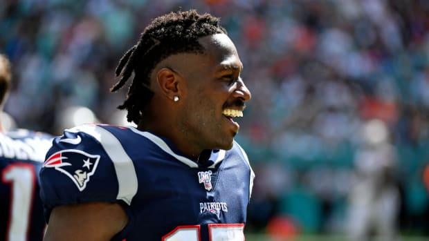 NFL receiver Antonio Brown smiles in a Patriot uniform