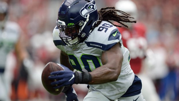 Seattle Seahawks outside linebacker Jadeveon Clowney (90) returns an interception for a touchdown against the Arizona Cardinals during the first half at State Farm Stadium.