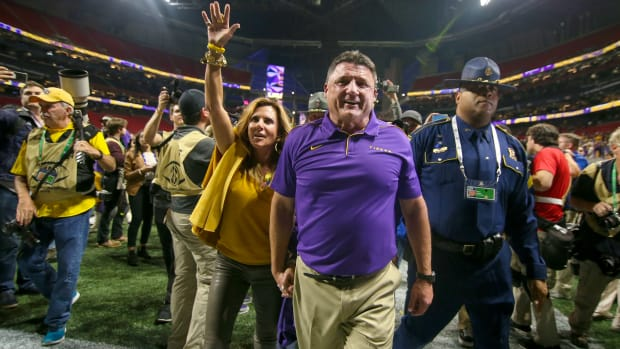 Dec 7, 2019; Atlanta, GA, USA; LSU Tigers head coach Ed Orgeron celebrates with wife Kelly Orgeron after a victory against the Georgia Bulldogs in the 2019 SEC Championship Game at Mercedes-Benz Stadium. Mandatory Credit: Brett Davis-USA TODAY Sports