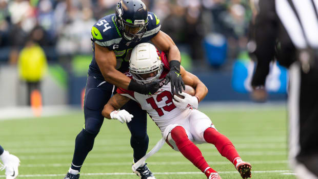 Seattle Seahawks middle linebacker Bobby Wagner (54) tackles Arizona Cardinals wide receiver Christian Kirk (13) during the first half at CenturyLink Field. Arizona defeated Seattle 27-13.