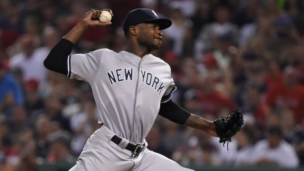 Domingo German pitches for the Yankees during a road game at Fenway Park.