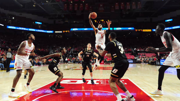 Maryland Terrapins guard Eric Ayala (5) lays the ball up in the first half against the Bryant Bulldogs at XFINITY Center.