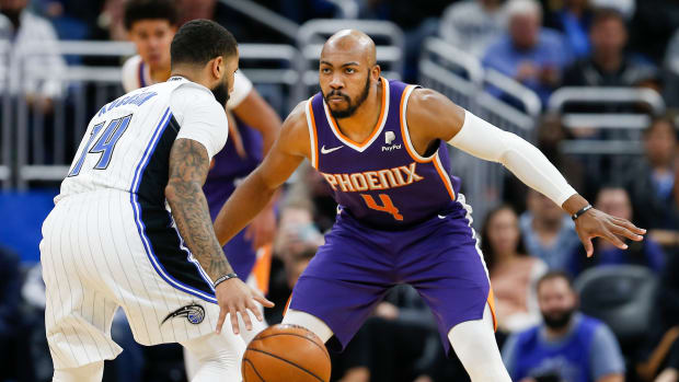 Phoenix Suns guard Jevon Carter (4) guards Orlando Magic guard D.J. Augustin (14) during the second half at Amway Center.