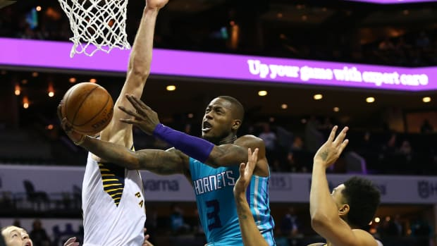 Jan 6, 2020; Charlotte, North Carolina, USA; Charlotte Hornets guard Terry Rozier (3) shoots the ball against Indiana Pacers forward Domantas Sabonis (11) during the second half at Spectrum Center. Mandatory Credit: Jeremy Brevard-USA TODAY Sports