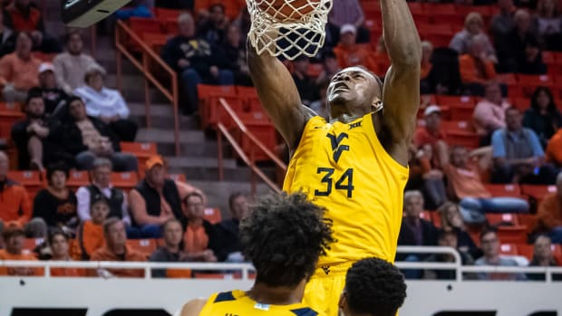 West Virginia Mountaineers forward Oscar Tshiebwe (34) dunks against the Oklahoma State Cowboys during the second half at Gallagher-Iba Arena. Mandatory