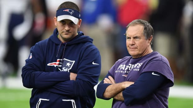 Joe Judge stands alongside Bill Belichick before the Super Bowl in 2017.