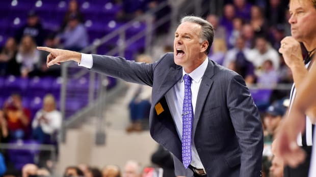 Jan 4, 2020; Fort Worth, Texas, USA; TCU Horned Frogs head coach Jamie Dixon commandos the court during overtime at Ed and Rae Schollmaier Arena. Mandatory Credit: Tim Flores-USA TODAY Sports