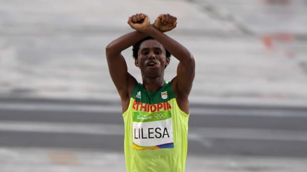 Feyisa Lilesa protests the Ethiopian government during the men's marathon at the 2016 Olympics in Rio de Janeiro
