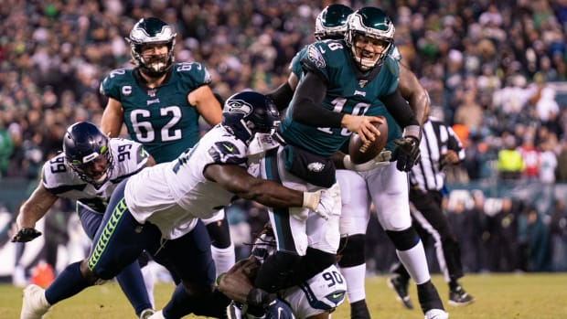 Eagles QB Josh McCown is tackled during NFL playoffs vs Seahawks
