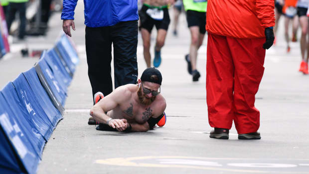 Marine veteran Micah Herndon crawls to the finish line of the 2019 Boston Marathon.