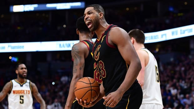 Cavaliers center Tristan Thompson shouts after making a shot against the Nuggets.