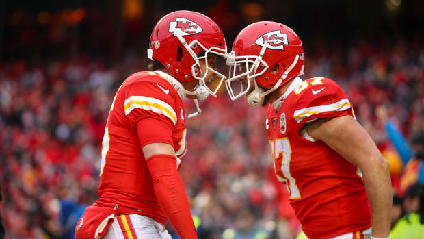 Patrick Mahomes and tight end Travis Kelce celebrate a touchdown against the Houston Texans during the second quarter in a AFC Divisional Round playoff football game at Arrowhead Stadium.