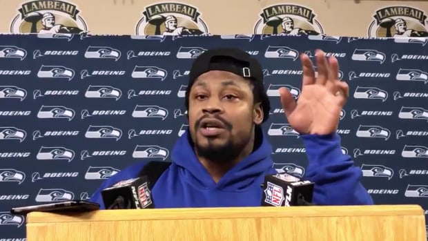 Seahawks RB Marshawn Lynch speaks at a press conference after NFL playoff loss to Packers