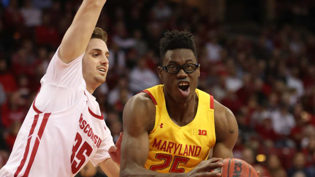 Maryland Terrapins forward Jalen Smith (25) looks to shoot as Wisconsin Badgers forward Nate Reuvers (35) defends during the first half at the Kohl Center.
