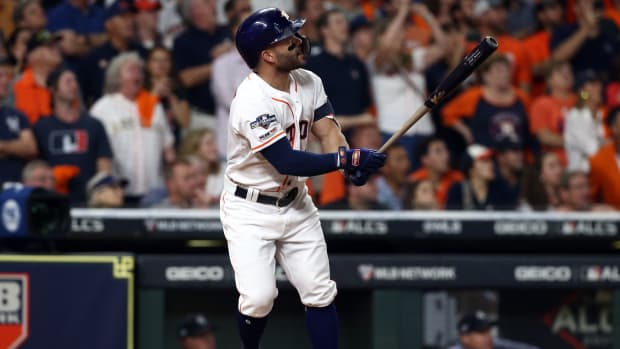 Houston Astros second baseman Jose Altuve hits a 2-run walk off home run during the ninth inning against the New York Yankees in game six of the 2019 ALCS playoff baseball series at Minute Maid Park.