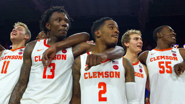 Five Clemson men's basketball players with their arms around each other