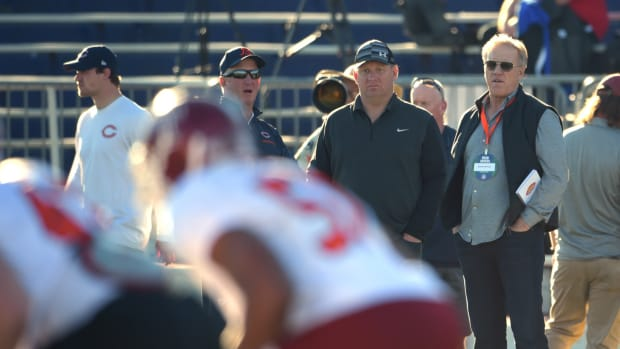 Denver Broncos former quarterback and current executive vice president of football operations and general manager John Elway (right) looks on during Senior Bowl north squad practice at Ladd-Peebles Stadium.