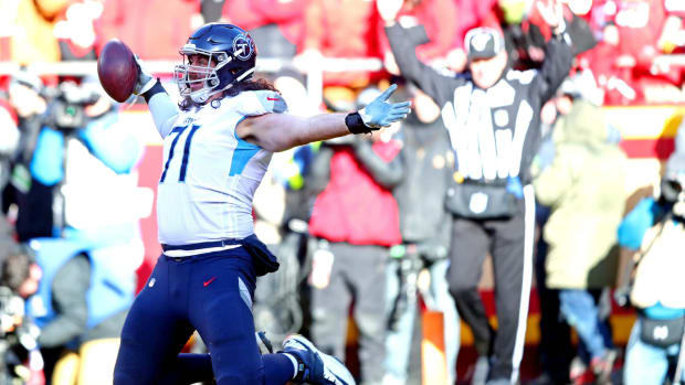 Tennessee Titans offensive tackle Dennis Kelly (71) celebrates after scoring a touchdown during the first half against the Kansas City Chiefs in the AFC Championship Game at Arrowhead Stadium.