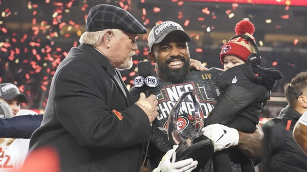 49ers running back Raheem Mostert is interviewed on the podium by Terry Bradshaw after NFC Championship Game