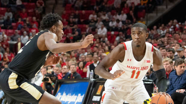 Maryland Terrapins guard Darryl Morsell (11) dribbles as Purdue Boilermakers guard Eric Hunter Jr. (2) defends during the second half at XFINITY Center.