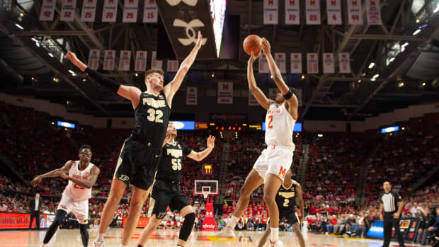 Maryland Terrapins guard Aaron Wiggins (2) shoots over Purdue Boilermakers center Matt Haarms (32) during the second half at XFINITY Center.