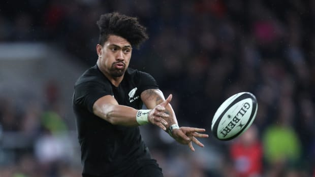 New Zealand All Blacks rugby player Ardie Savea makes a pass during a match
