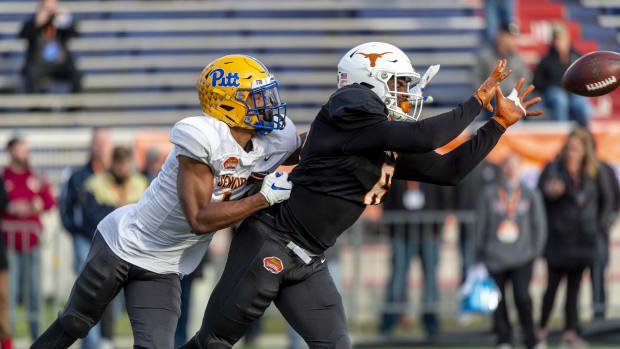 South cornerback Dane Jackson of Pittsburgh (11) and South wide receiver Devin Duvernay of Texas (6) spar in passing drills during Senior Bowl practice at Ladd-Peebles Stadium.