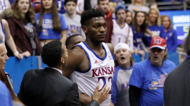 The Big 12 suspended four players following the Kansas-Kansas State brawl.