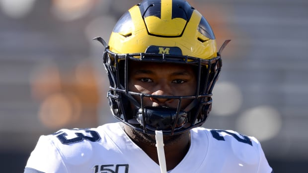 Michigan Wolverines running back Jordan Castleberry (23) warms up for the game against the Illinois Fighting Illini at Memorial Stadium.