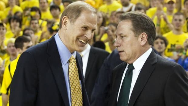 John Beilein and Tom Izzo visit in Ann Arbor prior to another hardcourt battle.  Photo courtesy of Mark Boomgaard.