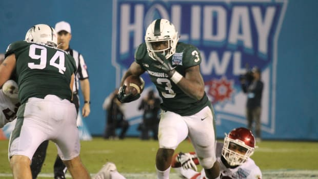 LJ Scott breaks free in the Holiday for the Spartans. (Photo: Duffy Carpenter, Spartan Nation @DuffyCarpenter1)
